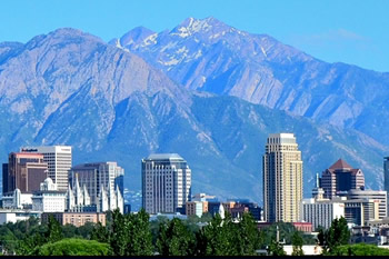 EB-5 Regional Center in Utah. Photo of downtown Salt Lake City, Utah with mountains in the background.